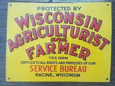 Wisconsin Agriculturist and Farmer Metal Sign with original brown paper cover.