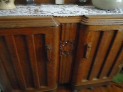Vintage solid oak sideboard with some carved detail to front middle panel