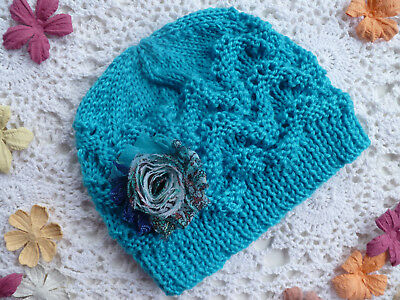 Cute hand-knitted baby girl's lacy beanie w flower to fit 9-18 months, acrylic