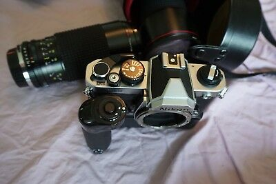 Nikon FM2 with strap, MD4 Motor DR,  camera case and 2 Tokina lenses