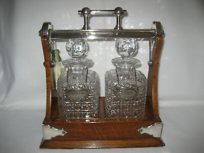 20th Century Grinsells Patent Oak Tantalus with 2 Cut Glass Decanters, + Key.