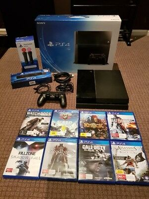 Sony PlayStation 4 500 GB Console with 8 games, camera and 2 move controllers