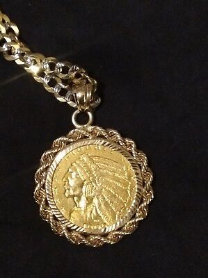 uncirculated gold 1909 indian head 2 1/2 dollar coin on a 10kt. Gold necklace.