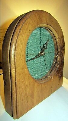 Lovely solid Oak clock made from sustainable oak with a light tartan cloth face.