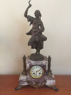French marble clock with bronze spelter figure on top