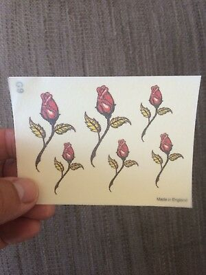 1x sheet of Temporary tattoos. Six roses. Put on hand, back, foot, arm.
