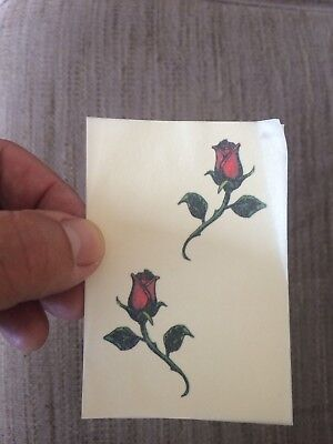 3x sheets of Temporary tattoos. two roses. Put on hand, back, foot, arm.