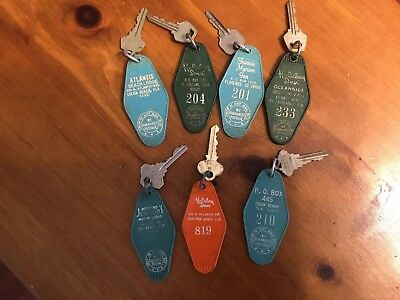 LOT OF 7 VINTAGE HOTEL MOTEL ROOM KEY TAG FOBS ACROSS FLORIDA, SC, Colorado.