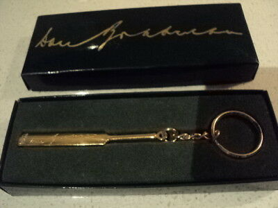Don Bradman 99.94 gold cricket bat key ring in original box