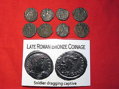 Ancient Roman coin 3rd 4th century AD Imperial Soldier deity dragging captive
