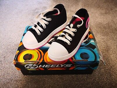 SIDEWALK SPORTS HEELYS...SIZE 12 (kids) EXCELLENT CONDITION  WITH BOX