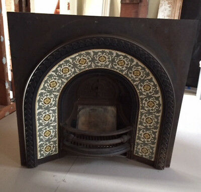 Cast iron fireplace insert with tiles