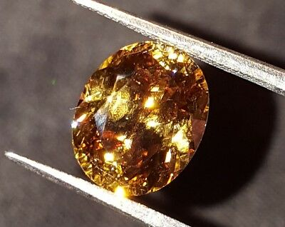 NATURAL CHAMPAGNE  ZIRCON 5.90 cts CUSTOM CUT OVAL (see video)