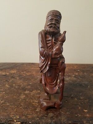 hand carved asian tree root figure