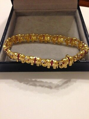 trés beau bracelet or 18 carat diamants rubis 21g