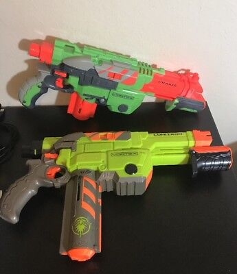 Lot of 2 Nerf Vortex Lumitron And Praxis Soft Disc Gun Blasters.  Work Great!