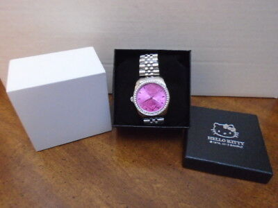 New in box Sanrio 2017 Hello Kitty pink logo silver toned analog watch
