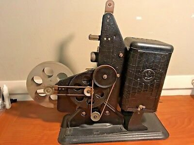 Antique Vintage Lindstrom 16mm Film Projector with cord and bulb