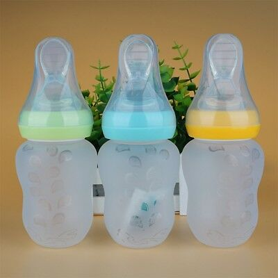 Baby Silicone Squeeze Feeding Bottle With Spoon Food Rice Cereal Feeder 180ML