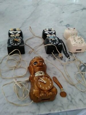 Three  -VINTAGE KIT CAT and one poodle CLOCK ORIGINAL for parts, not working