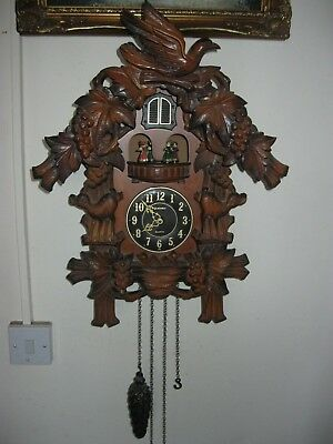 Wood Effect Black Forest Clock With Quartz Movement Cuckoo Chime Dancing Figures