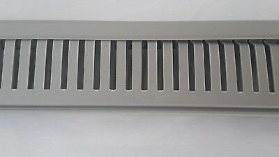 Slotted Grey Panel Trunking Duct with open slots. Narrow slots.