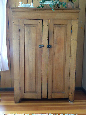 Antique tall walnut cupboard