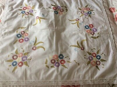 A lovely crisp small white vintage tablecloth with hand embroidered flowers and