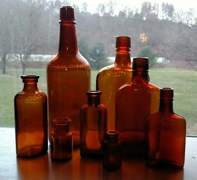 Lot of eight vintage amber whiskey snuff flask chemical pill bottles