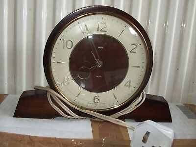 Two Old Electric Clocks