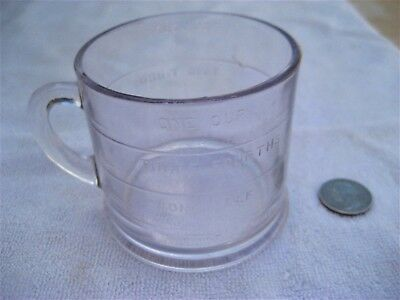 Old sun colored 8 ounce 1 cup glass measuring cup with quarter & third cup marks