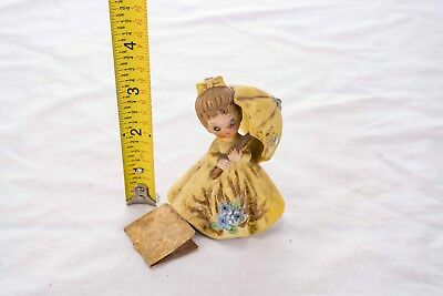 """Josef Originals girl in yellow dress with umbrella, about 3"""" to 4"""" tall."""