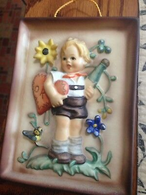 hummel wall plaque boy with heart and carrying a  bottle made in west Germany.