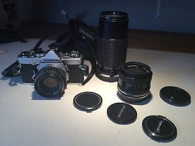 OLYMPUS OM-1 CAMERA + 50mm, 70-210mm and 28mm lens and case.