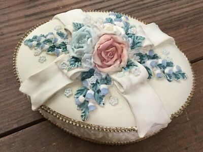 The San Fransisco Music Box Company Off White Oval Trinket Box Floral Bow Detail