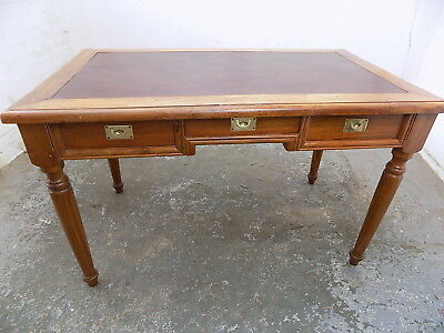 desk,hard wood,drawers,leather top,turned legs,brass handles,writing table,