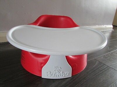 red bumbo seat with harness & playtray in excellent condition