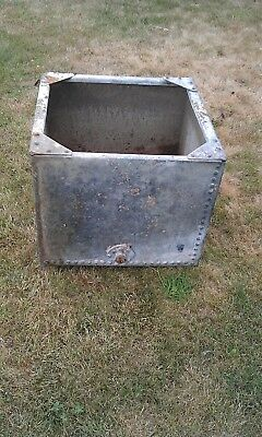 Vintage galvanized and riveted water tank/planter in Malvern
