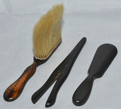 Antique ebony glove stretchers, ebony shoe horn and wooden table brush.