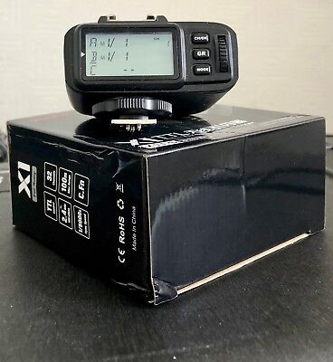Godox x1t-f Radio Flash Trigger. Updated Firmware and boxed