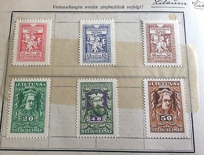 11 old stamps on paper Lithuania