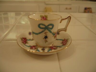 Vintage Crown Staffordshire Blue Bows And Roses Demitasse Cup And Saucer