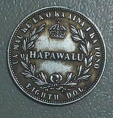 The coin is 1/8 of a dollar to 12.5 cents 1883 Hawaii