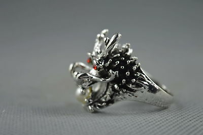 China Collectable Handwork Old Miao Silver Carve Dragon Bite Bead Exorcism Ring