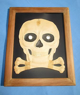 Framed Antique German Halloween Mask of a Skull.