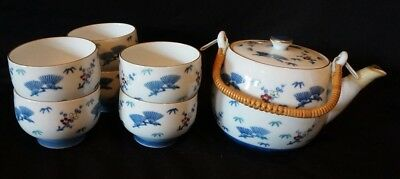 Vintage Japanese Teapot with Wicker Handle and Six Matching Cups. All Signed