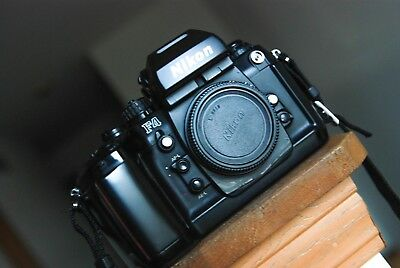 Nikon F4 camera body with cap and batteries