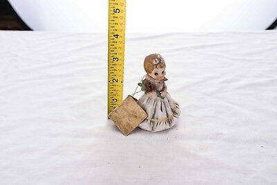 """Josef Originals girl in white dress with roses. About 4"""" tall."""
