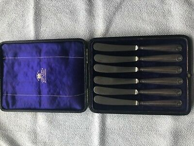 6 solid silver handled butter knifes