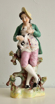 A c19th Antique Staffordshire Figure, A Country Boy with his Dog